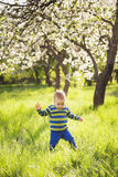 Child playing outside on spring warm sunny day royalty free stock images