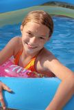 Child playing in paddling pool Stock Photography