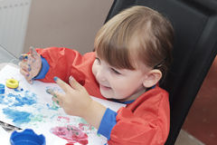 Child playing with paint Royalty Free Stock Image