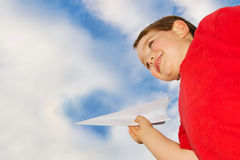Child playing with paper airplane Stock Photos