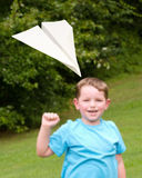 Child playing with paper airplane Royalty Free Stock Image