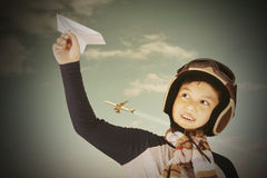 Child playing a paper plane Stock Photo