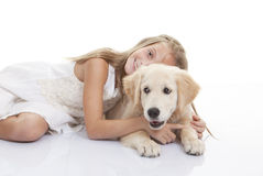 Child playing with pet dog royalty free stock photography