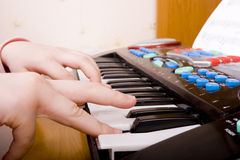 Child playing at piano Royalty Free Stock Image