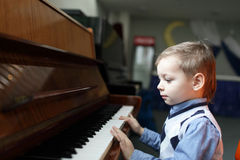 Child playing the piano Stock Photography