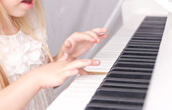 Child playing on piano Stock Photo