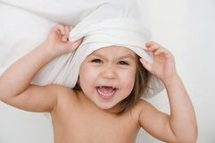 Child playing with pillow, self view point, happy smiling kid, domestic life, authentic kid stock images
