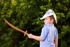 Child playing pirate in homemade costume Stock Photo