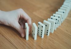 Child playing placing dominoes. royalty free stock photography