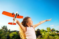 Child playing with plane Royalty Free Stock Photo