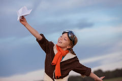 Child playing with plane travel Royalty Free Stock Image