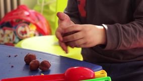 Child playing with plasteline stock video footage