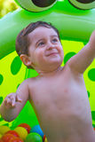 Child playing in plastic pool Stock Image