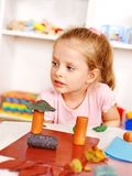 Child playing plasticine. Royalty Free Stock Image