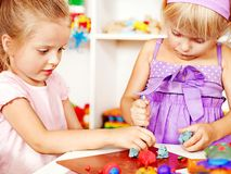 Child playing plasticine. Royalty Free Stock Images