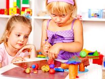 Child playing plasticine. Stock Photos