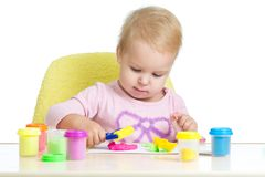Child playing with plasticine. Isolated on white background Royalty Free Stock Image
