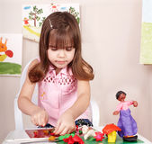 Child playing with plasticine in school. Little girl playing with plasticine in school Royalty Free Stock Photography