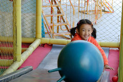 child playing in playground stock photo