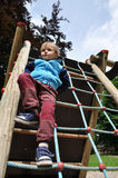 Child playing on playground. Young child playing on a rope playground Royalty Free Stock Photos