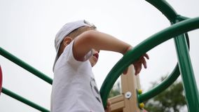 Child playing on the playground, coming up the stairs. Active outdoor sports stock video
