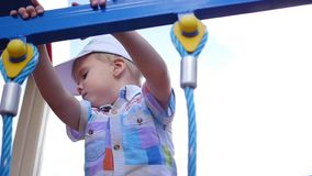 Child playing on the playground, coming up the stairs. Active outdoor sports stock video footage