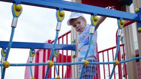 Child playing on the playground, coming up the stairs. Active outdoor sports stock footage