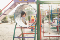 Child playing on playground in summer outdoor park Royalty Free Stock Photos