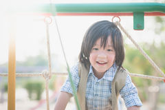 Child playing on playground in summer outdoor park Royalty Free Stock Images