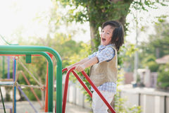 Child playing on playground in summer outdoor park Royalty Free Stock Photography