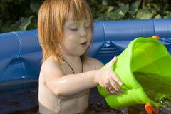 Child playing in a pool Stock Images
