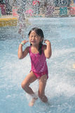 child playing pool swimming Стоковые Фотографии RF