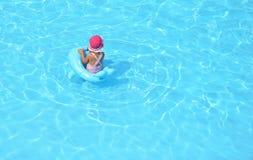 child playing pool swimming Стоковые Изображения