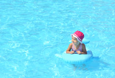 child playing pool swimming Стоковая Фотография RF