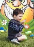 Child playing in preschool garden Stock Images