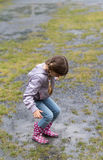 The child playing in a puddle Stock Photo