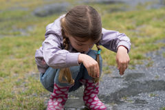 The child playing in a puddle Stock Photography