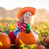 Child playing on pumpkin patch Stock Image