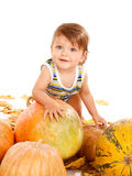 Child playing with pumpkins Stock Photo
