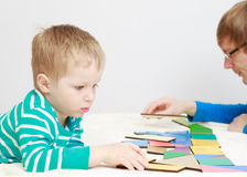 Child playing with puzzle Royalty Free Stock Photography