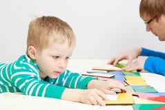 Child playing with puzzle Royalty Free Stock Photos