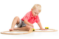 Child playing rail road toy Royalty Free Stock Photography
