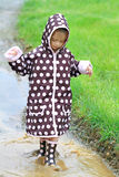 Child Playing in Rain Royalty Free Stock Photos
