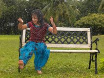 A child playing in the rain. Kid playing in the rain Stock Images