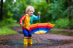 Child playing in the rain Royalty Free Stock Photo