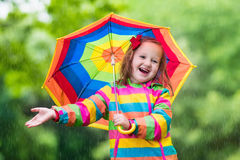 Child playing in the rain Royalty Free Stock Image