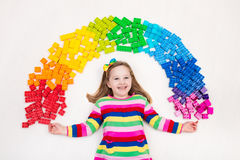 Child playing with rainbow plastic blocks toy Royalty Free Stock Photography