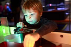 Child playing with refraction of light. In lab Stock Photography
