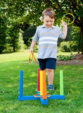 Child playing ring toss Royalty Free Stock Images