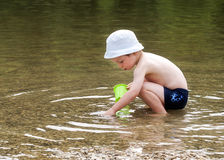 Child playing in river Royalty Free Stock Image